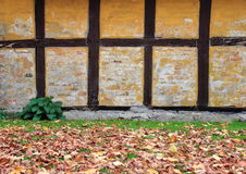 Worn half-timbered cottage house wall in autumn Royalty Free Stock Photos
