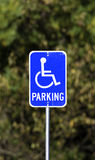 Worn handicapped parking sign Stock Photos
