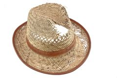Worn And  Holey Isolated Straw Hat. Worn And  Holey Straw Hat Isolated On White Background Royalty Free Stock Photography