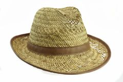 Worn And  Holey Isolated Straw Hat. Worn And  Holey Straw Hat Isolated On White Background Royalty Free Stock Photos