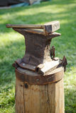 Worn iron anvil and hammer Stock Image