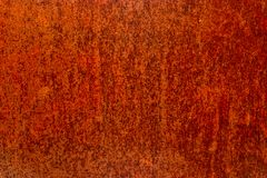 Worn iron sheet covered with red rust stock images