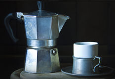 Worn Italian coffee maker and cup Stock Photos