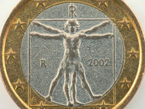 Worn italian one euro coin. Close up picture of a worn italian one euro coin stock image