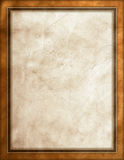 Worn leather background. Worn brown leather with dark brown & gold frame Stock Photography