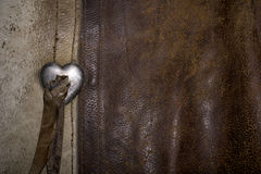Western Cowboy Worn Leather with a Heart Buckle  Stock Photography