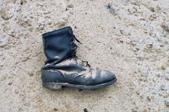 Worn leather military boots Stock Images