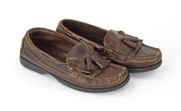 Worn leather tassel loafers stock photography