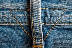 Worn lue jeans, Denim texture, macro background for web site or mobile devices. Closeup of blue jeans apron, Denim texture, macro background for web site or Royalty Free Stock Photography