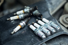 Worn and new spark plugs Stock Image