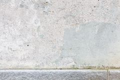 Worn old painted concrete wall Stock Photo