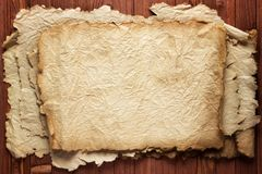 Worn old paper wood table, background for text. Ancient scrolls background wooden table, texture old paper and wood stock photos