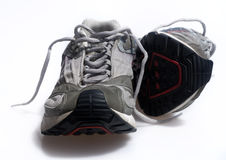 Worn old sneaker trainers. Set against white background. High contrast version Stock Image