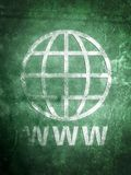 Worn old world wide web. Internet globe symbol on textured background royalty free stock photography