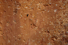 Worn orange plaster texture Royalty Free Stock Photo