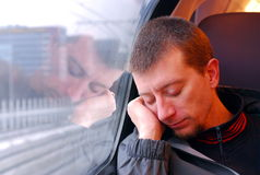 Worn Out. A man asleep on a commuter train in the Netherlands Royalty Free Stock Image