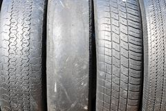 Worn out bald old car tire Royalty Free Stock Photography