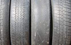Worn out bald old car tire Stock Image