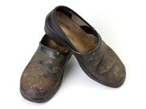 Worn out clogs Stock Photo