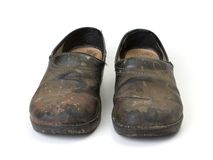 Worn out clogs Stock Images