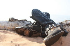 Worn out cowboy boots. On the beach royalty free stock images