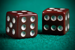 Worn Out Dices. A pair of retro looking worn out dices Royalty Free Stock Images
