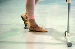 Worn out feet from daning ballet. Ugly and sore feet from dancing in a ballet studio royalty free stock image