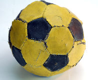 Worn-out football. At the end of the rood ready to been thrown away Royalty Free Stock Image