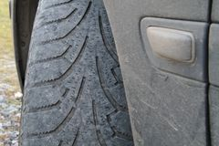 Worn out front tire. Of a car blinker change fender grip ice inspection marks old rubber safety side slick ticket tires traffic transportation unsafe used royalty free stock photos