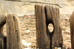 Worn out groynes Stock Photography