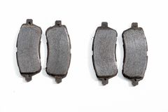 Worn out old rusty brake pads. Removed from a car royalty free stock photography