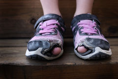 Worn Out Old Shoes with Holes in Toes Homeless Child Royalty Free Stock Images