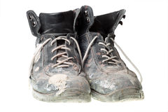 Worn-out old work boots, isolated on white. Stock Image