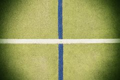 Worn out plastic hairy carpet on outside hanball court. Floor with colorful marking lines. Royalty Free Stock Photography