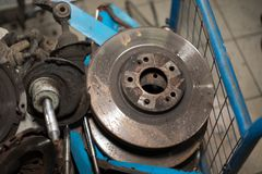 Worn out rusty brake discs and other parts - Image royalty free stock images