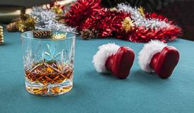 Worn Out Santa Claus - Christmas Eve !. Worn Out Santa Claus - drink and Santa's boots upended stock photo