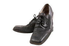 Worn out shoes. Worn out mens business shoes isolated on a white background Royalty Free Stock Photos