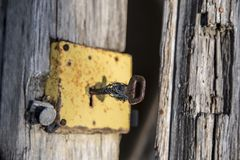 Broken and unused door. Worn out unusable lock without any valid use of which only unserviceable remains remain Royalty Free Stock Photos