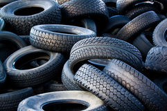 Worn out used tires. A large pile of used, worn-out and discarded automobile tires or tyres Royalty Free Stock Photo