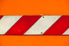 Worn out warning sign in orange, red and white Stock Photos