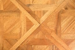 Worn out wooden floor of castle hall. Light wood flooring. Worn by use with defect Stock Image