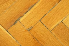 Worn out wooden floor of sports hall. Light wood flooring worned by use and time Royalty Free Stock Image