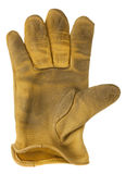 Worn out yellow leather glove Stock Photos