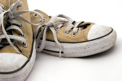 Worn Pair of Sneakers. On white background Stock Image
