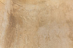 Worn pale yellow wall background Royalty Free Stock Images