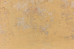 Worn pale yellow wall background Stock Images