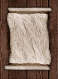 Worn Parchment Paper On a Wooden Rustic Background royalty free stock photos