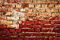 Worn red brick wall hald of deep red color royalty free stock photo
