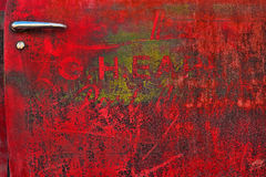 Worn red car door. Details of an old worn and weather-beaten car door painted red Royalty Free Stock Photos