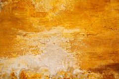 Worn rough surface yellow. Old wall. Abstract orange texture Stock Photo